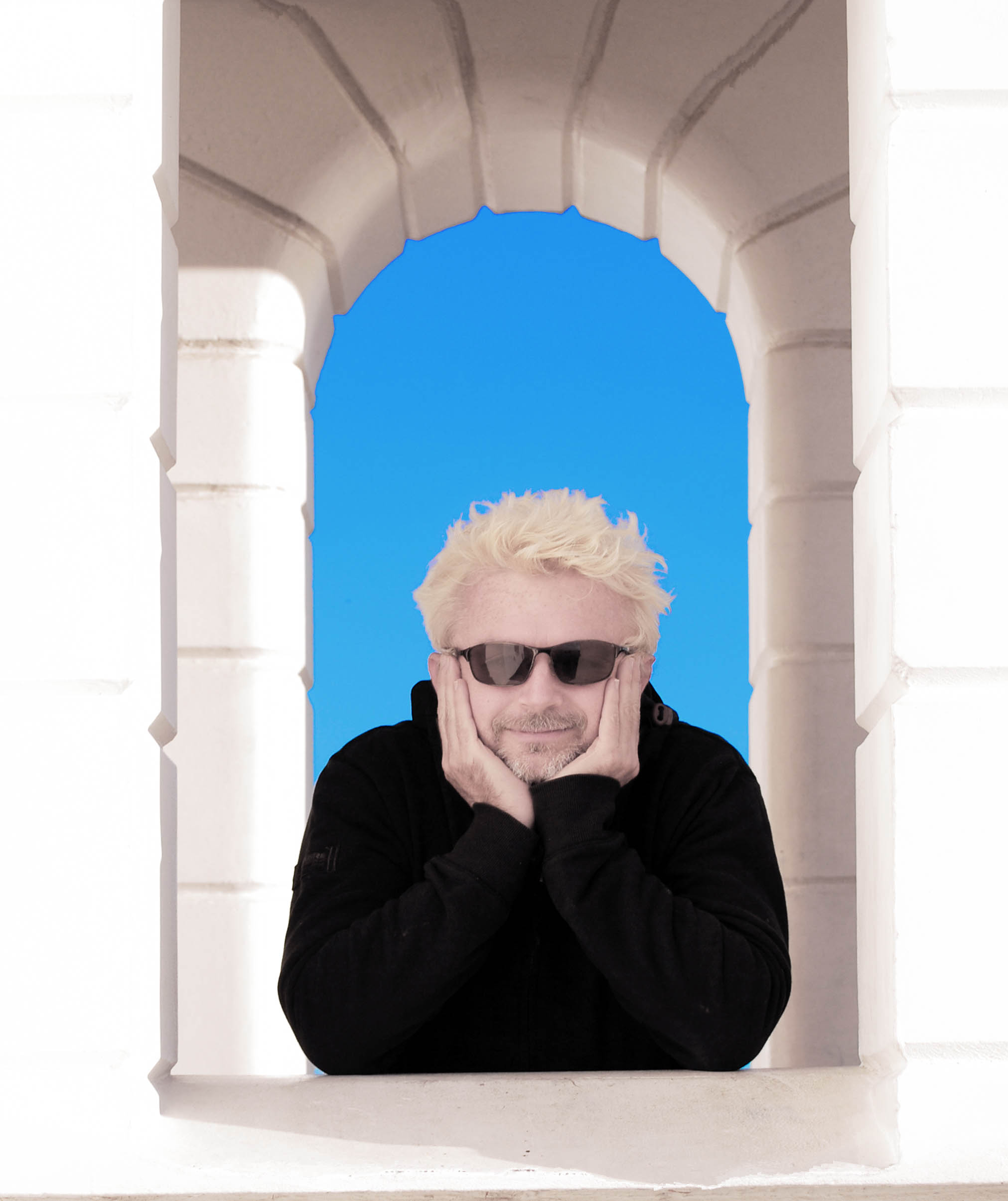Photo of gorgeous bloke looking through  an archway.